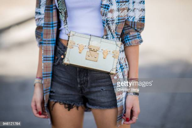 Lisa Hahnbueck wearing a checked Burberry button shirt white tank top Urban Outfitters jeans shots Levis Chloe boots Louis Vuitton bag is seen on...