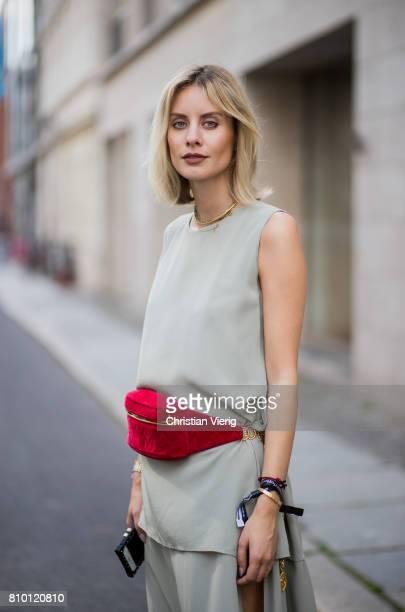 Lisa Hahnbueck wearing a Mykke Hofmann dress, vintage Chanel belt bag, Balenciaga x Colette knife boots during the Mercedes-Benz Fashion Week Berlin...