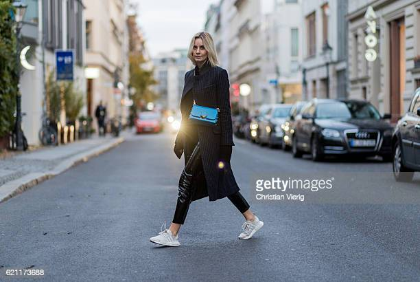 Lisa Hahnbueck wearing a navy white stripped Asos coat black Patent Leather Pants New Look via Asos a black HM Trend Mohair Blend Knit white creme...