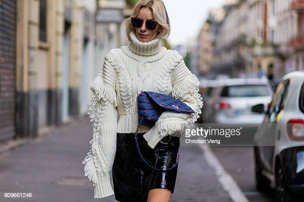 Lisa Hahnbueck wearing a OffWhite Knit Turtle Neck Oversized Sleeves Fringes Mango Asymmetric Patent Leather Skirt with Belt Louis Vuitton GO14 PM...
