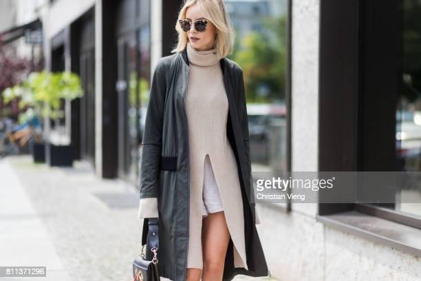 Lisa Hahnbueck wearing a Strenesse Long bomber jacket, Agnona Cashmere turtle neck sweater, Gina Tricot linen shorts, Mai Piu Senza high heels, JW...