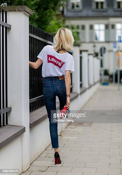 Lisa Hahnbueck wearing a white Levis tshirt and navy Levis denim jeans and Miista heels on June 1 2016 in Duesseldorf Germany