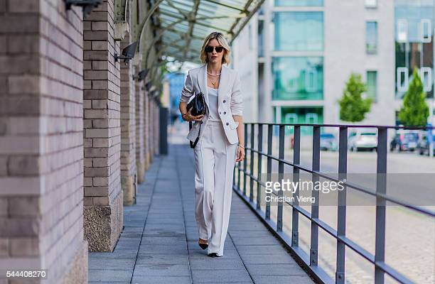 Lisa Hahnbueck wearing a white Marc Cain suit during the MercedesBenz Fashion Week Berlin Spring/Summer 2017 on June 28 2016 in Berlin Germany
