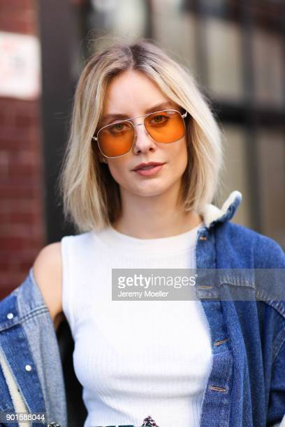 Lisa Hahnbueck wearing a Yproject denim jacket Nike Tn sneaker Massimo dutti skirt and Vogue Eyewear x Gigi Hadid Sunglasses on September 04 2017 in...
