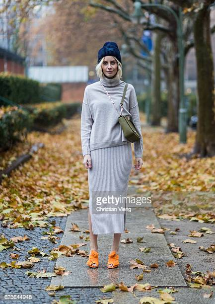 Lisa Hahnbueck wearing Allude Cashmere Turtle Neck Beige Melange Allude Cashmere Knit Skirt Beige Melange Aigner Lucy Bag in Moss Green Charlotte...
