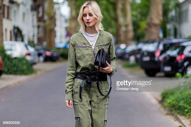 Lisa Hahnbueck wearing an olive overall from Set Chanel bag on June 1 2016 in Duesseldorf Germany