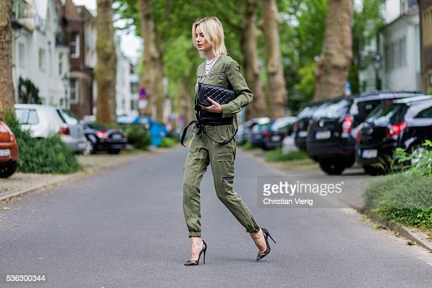 Lisa Hahnbueck wearing an olive overall from Set Louboutin heels Chanel bag on June 1 2016 in Duesseldorf Germany