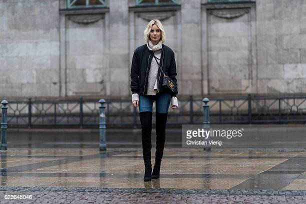 Lisa Hahnbueck wearing black NAKD Lacing Bomber Jacket / Lace Detail In The Back a grey Duffy Big Knit Turtle Neck black JBrand Carolina High Rise...