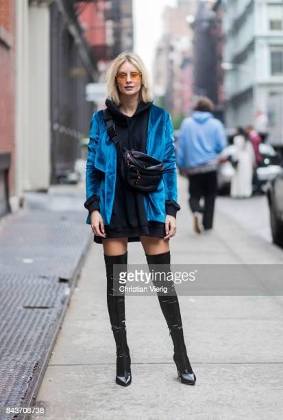 Lisa Hahnbueck wearing black overknee boots blue velvet jacket oversized black hoody belt bag vogue eyewear x Gigi Hadid sunglasses on September 6...