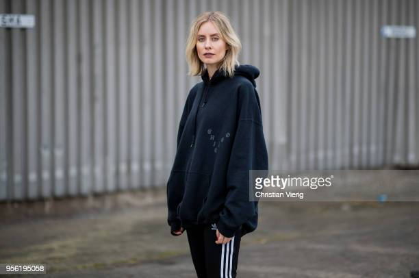 Lisa Hahnbueck wearing black oversized hoody black Adidas track suit pants red velvet boots on May 3 2018 in Duesseldorf Germany