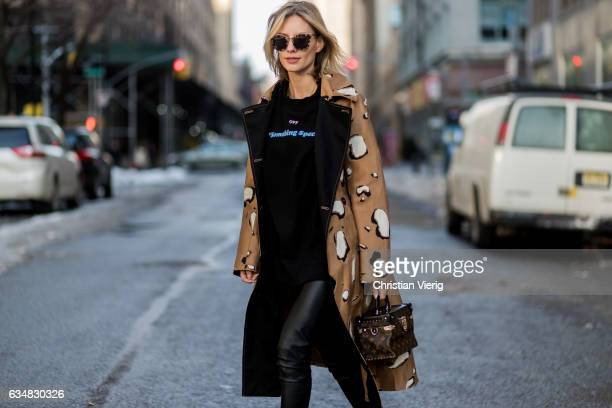 Lisa Hahnbueck wearing black sweater brown trench coat Louis Vuitton bag black leather pants olive ankle boots on February 11 2017 in New York City