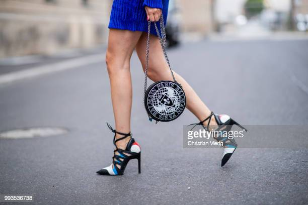 Lisa Hahnbueck wearing blue knit dress Balmain round Balmain bag Louis Vuitton high heels during the Berlin Fashion Week July 2018 on July 6 2018 in...