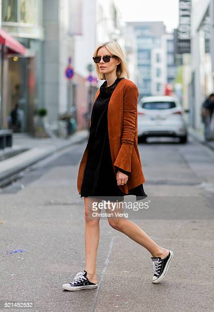 Lisa Hahnbueck wearing bronze buckskin blazer from Hironae Paris a black sweater from Rick Owens a black leather skirt from Urban Outfitters black...