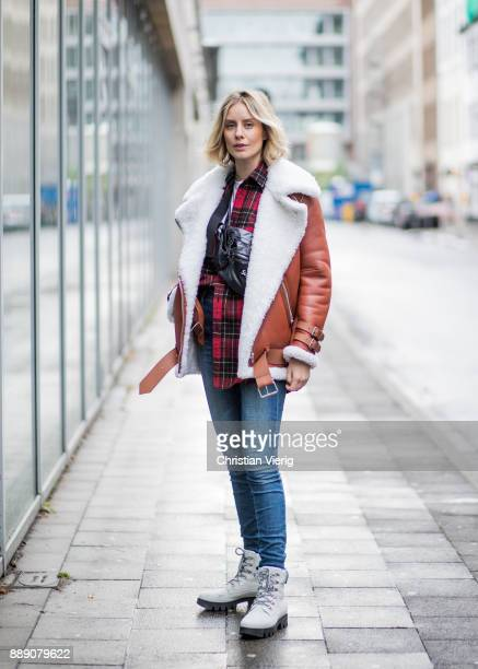 Lisa Hahnbueck wearing brown Acne Studios pistol leather jacket with inner lining red checked Saint Laurent button shirt blue J Brand jeans white...