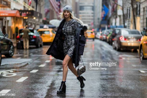 Lisa Hahnbueck wearing Canada Goose Resolute Parka Isabel Marant Gathered Tartan Dress in Cotton via Stylebop Louis Vuitton STAR TRAIL ANKLE BOOT...