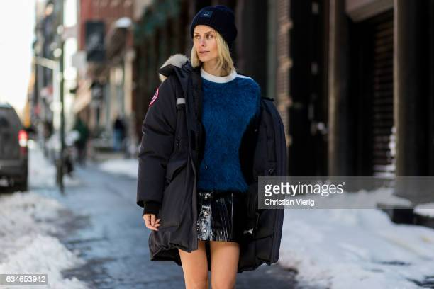 Lisa Hahnbueck wearing Canada Goose Resolute Parka Louis Vuitton RTW Mohair Knit Naplack And Leather Miniskirt Louis Vuitton STAR TRAIL ANKLE BOOT...