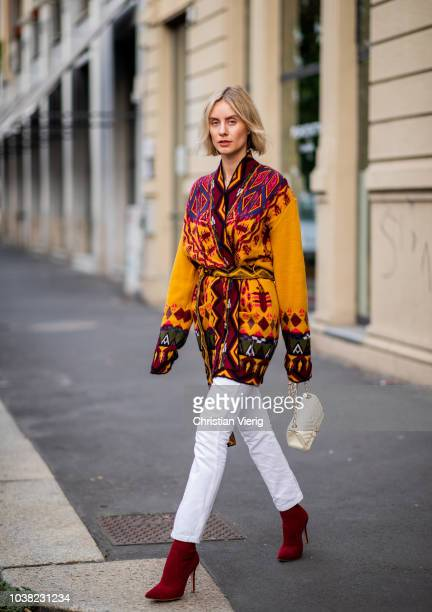 Lisa Hahnbueck wearing cardigan Etro white jeans Re/Done Levis Gianvitto Rossi shoes Chanel bag is seen during Milan Fashion Week Spring/Summer 2019...