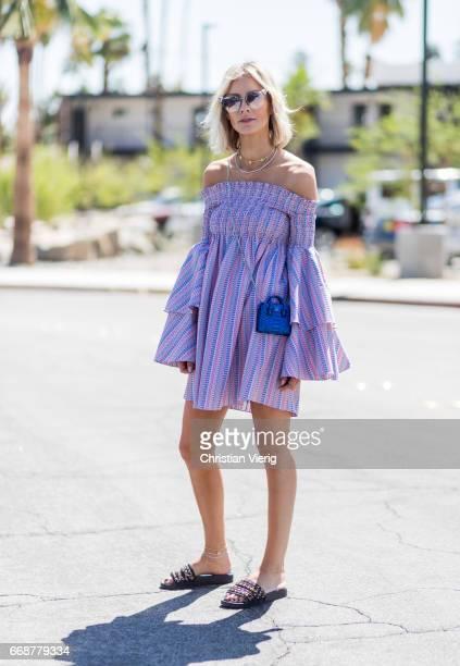 Lisa Hahnbueck wearing Caroline Constas dress with statement sleeves Chanel slipper MCM Milla phyton credit card bag Fendi sunglasses Ariane Ernst...
