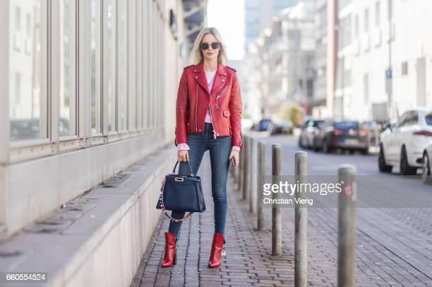 Lisa Hahnbueck wearing Coach ICON Moto Leather Jacket Jbrand Carola High Waist Jeans Urban Outfitters Cropped Sweatshirt Louis Vuitton Pokerface...