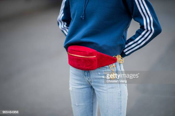 Lisa Hahnbueck wearing cropped Levis 501 denim jeans blue cropped Adidas hoodie Gianvito Rossi sock boots red vintage Chanel velvet fanny belt bag on...