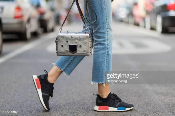 Lisa Hahnbueck wearing cropped Levis Wedgie denim jeans Adidas sneakers Jimmy Choo Lockett bag on July 17 2017 in Berlin Germany