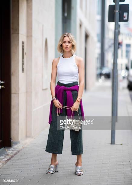 Lisa Hahnbueck wearing DAY Birger et Mikkelsen crooped wide leg pants, white top, Roger Vivier bag, Gucci heels during the Berlin Fashion Week July...