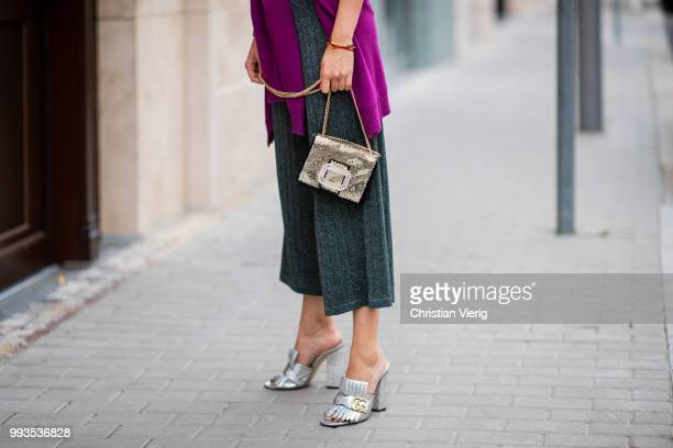 Lisa Hahnbueck wearing DAY Birger et Mikkelsen crooped wide leg pants white top Roger Vivier bag Gucci heels during the Berlin Fashion Week July 2018...