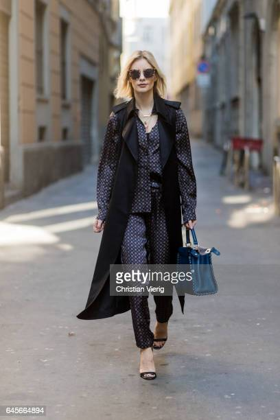Lisa Hahnbueck wearing Designers Remix Pyjama Shirt and Pyjama Pants, Victoria Beckham Sleeveless Satin Coat, MSGM Fake Fur Vest, Fendi Peekaboo bag,...