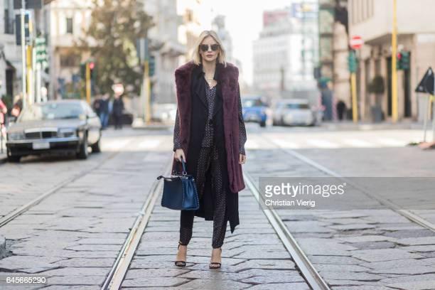 Lisa Hahnbueck wearing Designers Remix Pyjama Shirt and Pyjama Pants Victoria Beckham Sleeveless Satin Coat MSGM Fake Fur Vest Fendi Peekaboo bag...