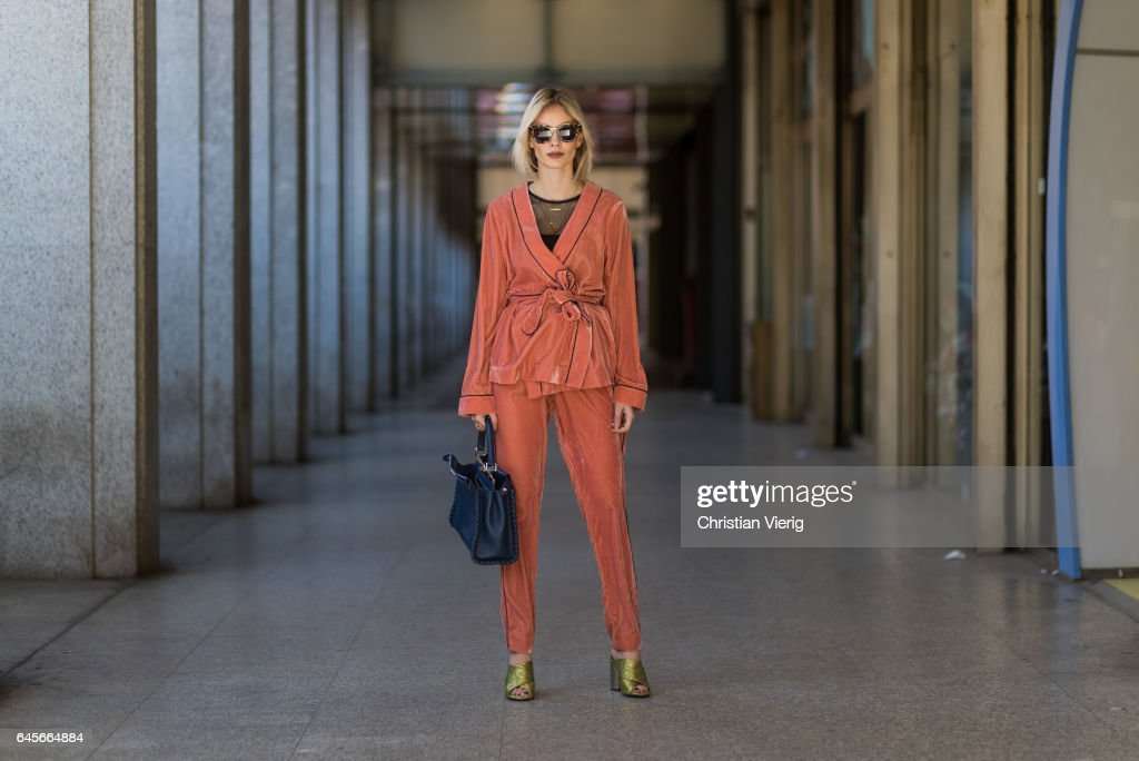Lisa Hahnbueck wearing Designers Remix Velvet Pyjama Kimono and Pants, Topshop High Heels, Intimissimi Netshirt, Fendi Peekaboo bag, Prada Sunglasses during Milan Fashion Week Fall/Winter 2017/18 on February 26, 2017 in Milan, Italy.