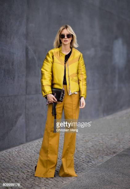 Lisa Hahnbueck wearing Dorothee Schuhmacher flared pants and yellow bomber jacket during the MercedesBenz Fashion Week Berlin Spring/Summer 2018 at...