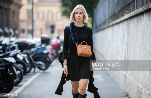 Lisa Hahnbueck wearing Ellery dress Fendi boots MCM with strap from Fendi is seen outside Blumarine during Milan Fashion Week Spring/Summer 2019 on...