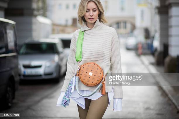 Lisa Hahnbueck wearing Gianvito Rossi high heels MCM x Koenigsouvenir bag knit pants button shirt with long sleeves Dorothee Schumacher is seen...