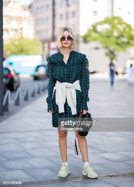 Lisa Hahnbueck wearing green checked dress, Louis Vuitton bag is seen outside Designers Remix during the Copenhagen Fashion Week Spring/Summer 2019...