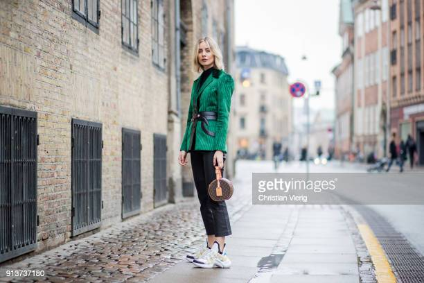 Lisa Hahnbueck wearing green corduroy Louis Vuitton jacket Set cropped leather pants Louis Vuitton bag and Louis Vuitton sneaker is seen during the...