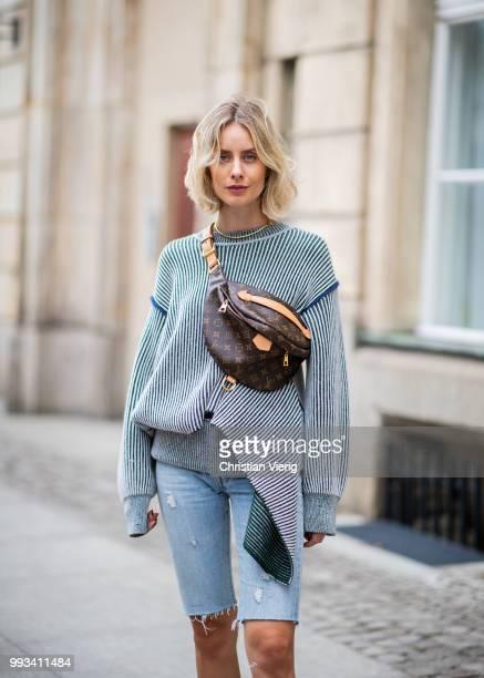 Lisa Hahnbueck wearing grey jumper Sportmax cropped denim jeans Levis Yeezy 500 x adidas sneaker Louis Vuitton bun bag seen during the Berlin Fashion...