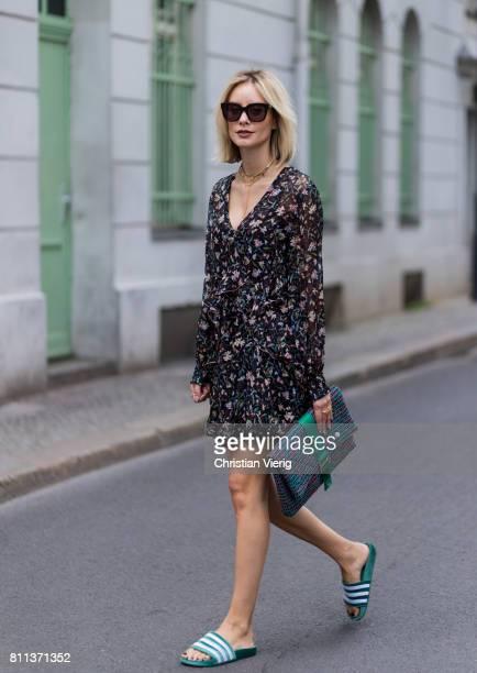 Lisa Hahnbueck wearing IRO flower hippie dress Chanel tweed clutch Adidas green velvet adiletten pool slides during the MercedesBenz Fashion Week...