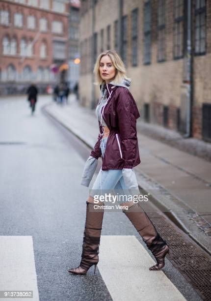 Lisa Hahnbueck wearing Isabel Marant parka grey cropped Off White hoodie cropped Levis denim jeans Jimmy Choot Elisabeth boots is seen during the...