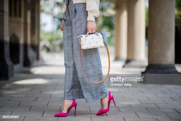 Lisa Hahnbueck wearing Isabel Marant summer knit grey flared Baum und Pferdgarten pants Fendi bag pink Louboution heels on May 3 2018 in Duesseldorf...