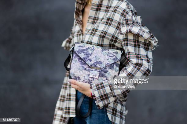 Lisa Hahnbueck wearing J Brand jeans, SJYP printed cotton blend shirt with statement sleeves, Balenciaga x Colette knife boots limited edition, Prada...