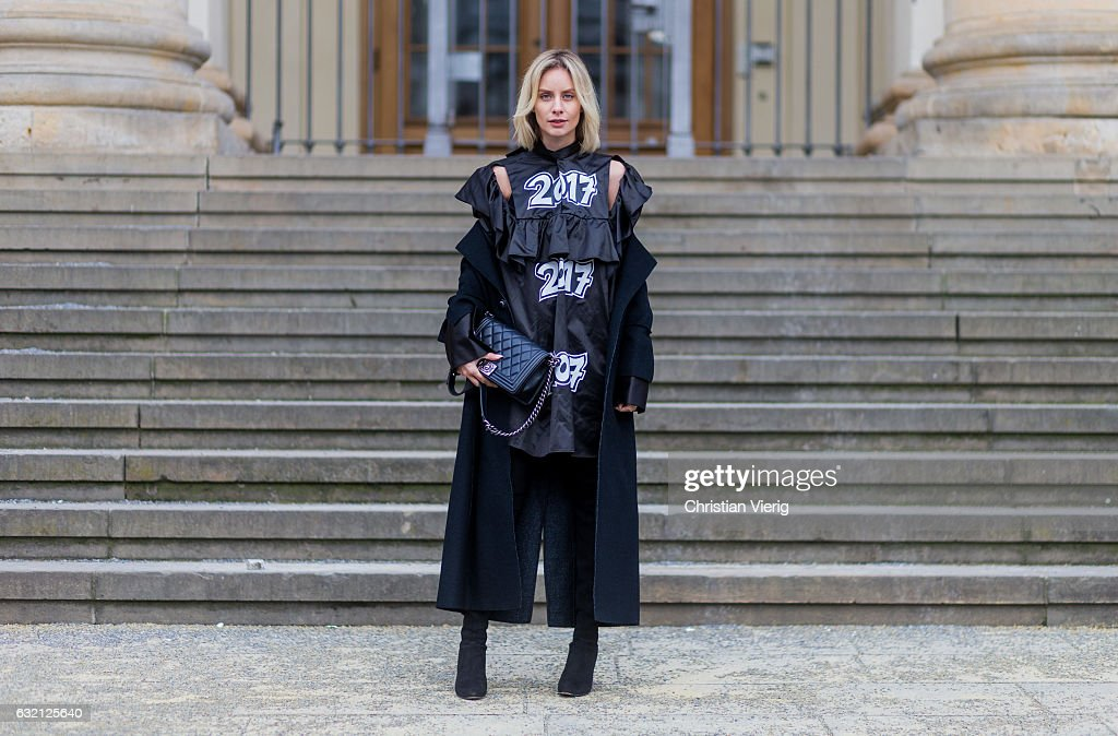 Lisa Hahnbueck wearing Julia Seeman Kleid, Marc Cain Maxicoat, Stuart Weitzman Alllegs Over Knee Boots, Chanel Boy Bag Medium size during the Mercedes-Benz Fashion Week Berlin A/W 2017 at Kaufhaus Jandorf on January 19, 2017 in Berlin, Germany.