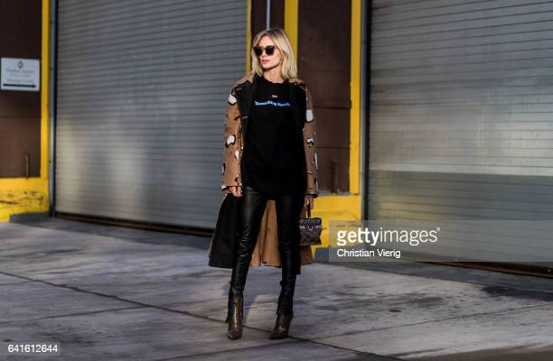 """Lisa Hahnbueck wearing Leopardspot cotton trench coat Bonvirage Leather Pants OffWhite """"Something Special"""" Printed Cotton Sweatshirt Balenciaga Boots..."""