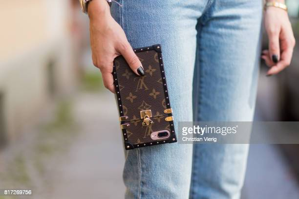 Lisa Hahnbueck wearing light toned cropped Levis Wedgie denim jeans, Louis Vuitton iphone cover on July 17, 2017 in Berlin, Germany.