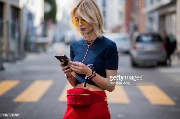 Lisa Hahnbueck wearing Louis Vuitton iphone case t by Alexander Wang cropped knit Victoria Beckham knit skirt red Chanel vintage belt bag Dior soreal...