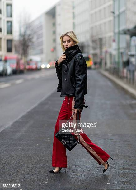 Lisa Hahnbueck wearing Maze Shanghai leatherjacket Chanel Bandshirt by Ecntrc Drykorn Jogging Pants Chanel Boy Bag Gianvito Rossi Plexi Heels during...