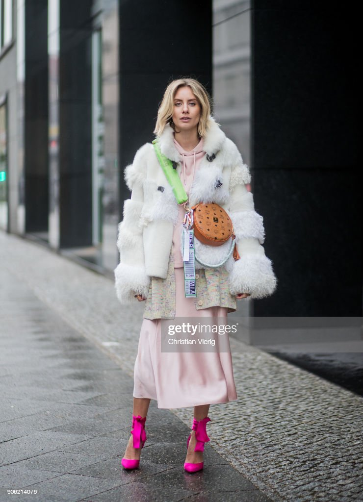 Lisa Hahnbueck wearing MCM x Koenigsouvenir bag, pink heels, rose dress, coat is seen outside Lana Mueller during the Berlin Fashion Week January 2018 on January 17, 2018 in Berlin, Germany.