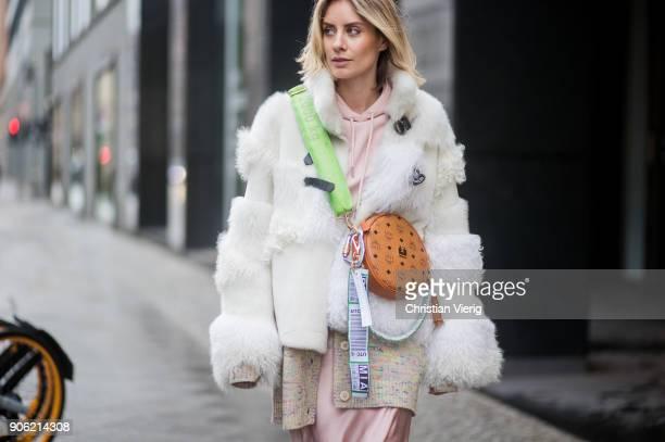 Lisa Hahnbueck wearing MCM x Koenigsouvenir bag pink heels rose dress coat is seen outside Lana Mueller during the Berlin Fashion Week January 2018...