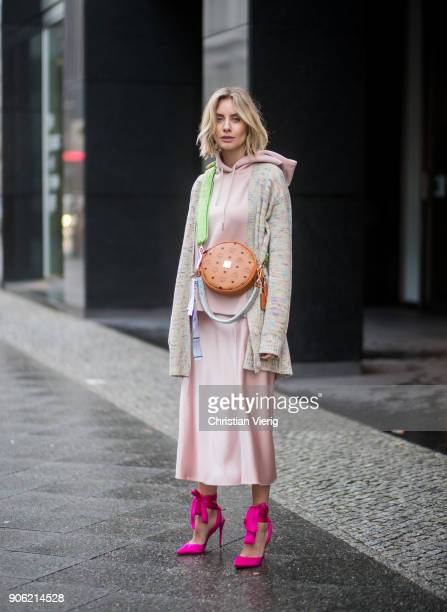 Lisa Hahnbueck wearing MCM x Koenigsouvenir bag pink heels rose dress coat is seen outside Lana Mueller during the Berlin Fashion Week January 2018...