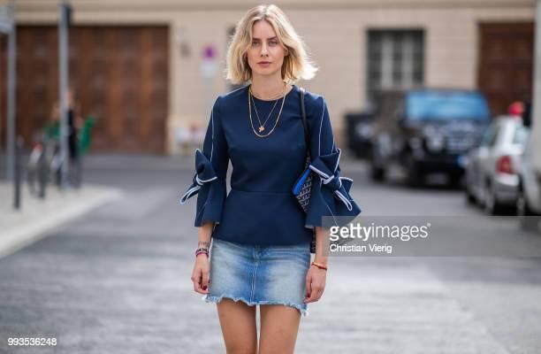 Lisa Hahnbueck wearing navy blue blouse with bow sleeves Roksanda denim mini skirt Frame Chanel Terry Cloth Slides slipper bag Goyard during the...