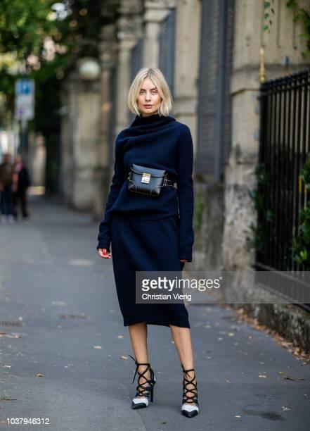 Lisa Hahnbueck wearing navy Jil Sander cashmere skirt and turtleneck Louis Vuitton heels MCM bag is seen outside Blumarine during Milan Fashion Week...